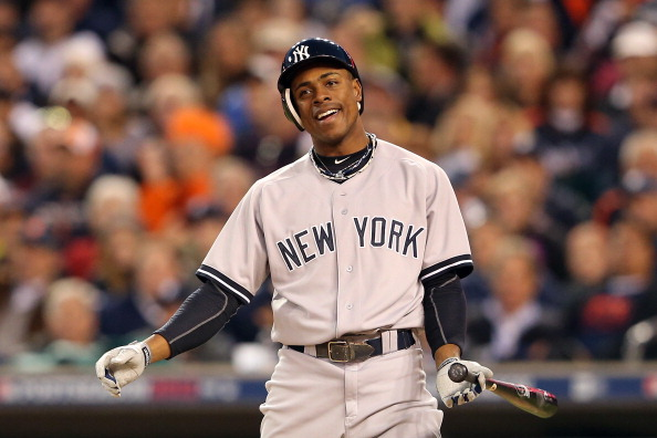 DETROIT, MI - OCTOBER 18:  Curtis Granderson #14 of the New York Yankees reacts after he struck out in the seventh inning against the Detroit Tigers during game four of the American League Championship Series at Comerica Park on October 18, 2012 in Detroit, Michigan.  (Photo by Leon Halip/Getty Images)