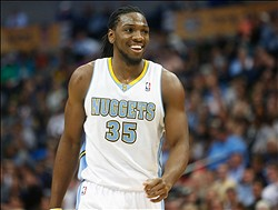 Nov 5, 2013; Denver, CO, USA; Denver Nuggets forward Kenneth Faried (35) reacts  during the second half against the San Antonio Spurs at Pepsi Center. The Spurs won 102-94. Mandatory Credit: Chris Humphreys-USA TODAY Sports