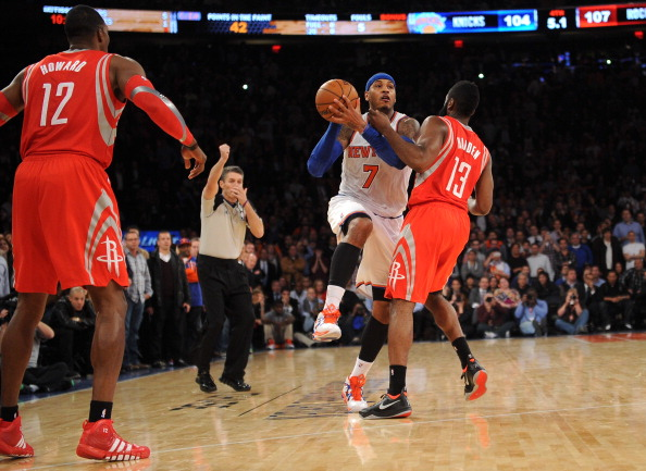 NEW YORK, NY - NOVEMBER 14: A personal foul is called on James Harden #13 of the Houston Rockets while  Carmelo Anthony #7 of the New York Knicks  takes a shot with five seconds left in the game at Madison Square Garden on November 14, 2013 in New York City. The Rockets defeat the Knicks 109-106. NOTE TO USER: User expressly acknowledges and agrees that, by downloading and/or using this photograph, user is consenting to the terms and conditions of the Getty Images License Agreement.  (Photo by Maddie Meyer/Getty Images)