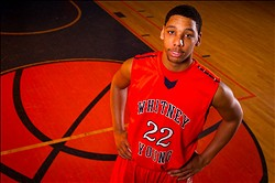 Apr. 3, 2013; Chicago, IL, USA; Varsity basketball team member Jahlil Okafor poses at Whitney M. Young Magnet High School in Chicago. Okafor, a 6 foot 10 inch junior who plays the center position, is poised to become one of the top basketball recruits for college teams in the country. Mandatory Credit: Guy Rhodes-USA TODAY Sports