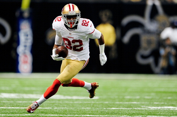 NEW ORLEANS, LA - NOVEMBER 25:  Mario Manningham #82 of the San Francisco 49ers runs for yards against the New Orleans Saints during a game at the Mercedes-Benz Superdome on November 25, 2012 in New Orleans, Louisiana.  (Photo by Stacy Revere/Getty Images)