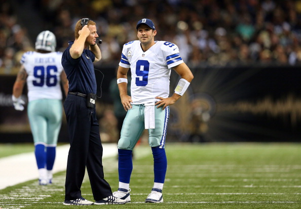 NEW ORLEANS, LA - NOVEMBER 10: Quarterback Tony Romo #9 of the Dallas Cowboys looks on with head coach Jason Garrett against the New Orleans Saints during a game at the Mercedes-Benz Superdome on November 10, 2013 in New Orleans, Louisiana.  (Photo by Ronald Martinez/Getty Images)