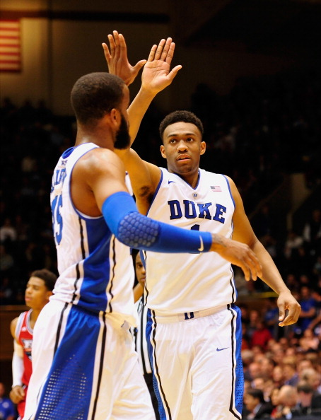 DURHAM, NC - NOVEMBER 15:  Josh Hairston #15 of the Duke Blue Devils high-fives teammate Jabari Parker #1 during a win over the Florida Atlantic Owls during play at Cameron Indoor Stadium on November 15, 2013 in Durham, North Carolina. Duke won 97-64.  (Photo by Grant Halverson/Getty Images)