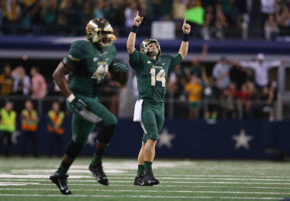 ARLINGTON, TX - NOVEMBER 16:  Bryce Petty #14 of the Baylor Bears celebrates a touchdown against the Texas Tech Red Raiders at AT&T Stadium on November 16, 2013 in Arlington, Texas.  (Photo by Ronald Martinez/Getty Images)
