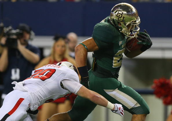 ARLINGTON, TX - NOVEMBER 16:  Devin Chafin #28 of the Baylor Bears runs for a touchdown against Tanner Jacobson #20 of the Texas Tech Red Raiders at AT&T Stadium on November 16, 2013 in Arlington, Texas.  (Photo by Ronald Martinez/Getty Images)