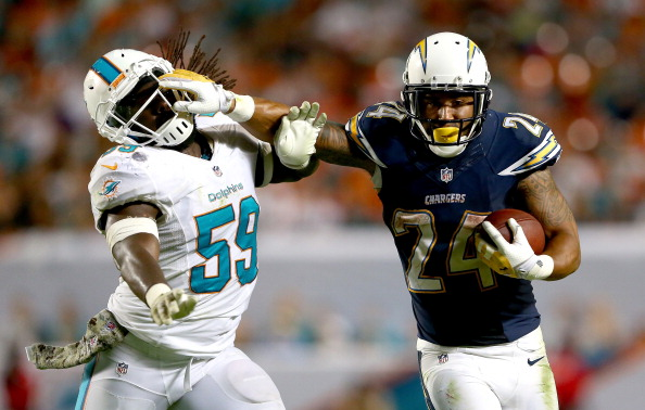 MIAMI GARDENS, FL - NOVEMBER 17:   Ryan Mathews #24 of the San Diego Chargers tries to get away from Dannell Ellerbe #59 of the Miami Dolphins during their game at Sun Life Stadium on November 17, 2013 in Miami Gardens, Florida.  (Photo by Streeter Lecka/Getty Images)