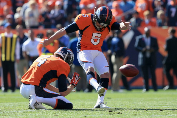 DENVER, CO - OCTOBER 13:  Place kicker Matt Prater #5 of the Denver Broncos kicks an extra point from the hold of punter Britton Colquitt #4 of the Denver Broncos against the Jacksonville Jaguars at Sports Authority Field at Mile High on October 13, 2013 in Denver, Colorado. The Broncos defeated the Jaguars 35-19.  (Photo by Doug Pensinger/Getty Images)