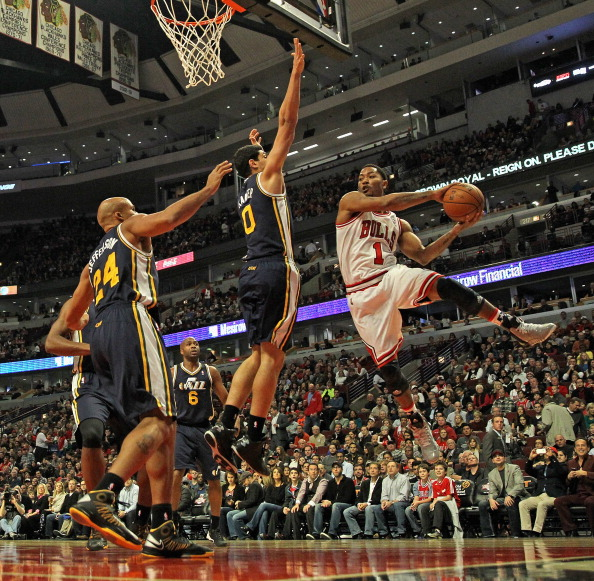 CHICAGO, IL - NOVEMBER 08: Derrick Rose #1 of the Chicago Bulls leaps to pass against Enes Kanter #0 and Richard Jefferson #24 of the Utah Jazz at the United Center on November 8, 2013 in Chicago, Illinois. NOTE TO USER: User expressly acknowledges and agrees that, by downloading and or using this photograph, User is consenting to the terms and conditions of the Getty Images License Agreement. (Photo by Jonathan Daniel/Getty Images)