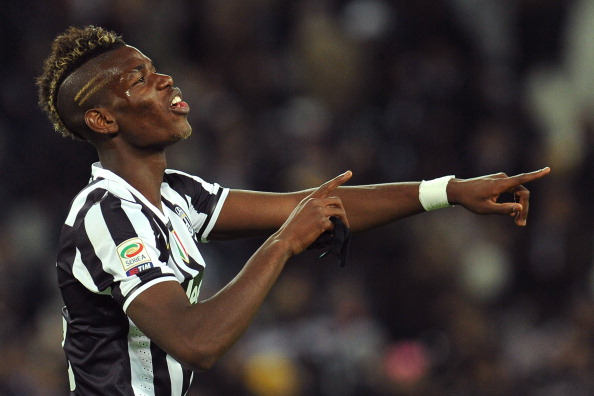 TURIN, ITALY - NOVEMBER 10:  Paul Pogba of Juventus celebrates victory at the end of the Serie A match between Juventus and SSC Napoli at Juventus Arena on November 10, 2013 in Turin, Italy.  (Photo by Valerio Pennicino/Getty Images)