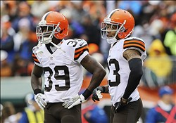 Nov 17, 2013; Cincinnati, OH, USA; Cleveland Browns free safety Tashaun Gipson (39) and Cleveland Browns cornerback Joe Haden (23) react during the first half against the Cincinnati Bengals at Paul Brown Stadium. Mandatory Credit: Kevin Jairaj-USA TODAY Sports