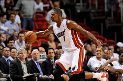Nov 19, 2013; Miami, FL, USA; Miami Heat center Chris Bosh (1) chases a loose ball out of bounds during the second half against the Atlanta Hawks at American Airlines Arena. Mandatory Credit: Steve Mitchell-USA TODAY Sports