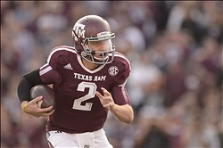 Nov 9, 2013; College Station, TX, USA; Texas A&M Aggies quarterback Johnny Manziel (2) scrambles against the Mississippi State Bulldogs during the second quarter at Kyle Field. Mandatory Credit: Thomas Campbell-USA TODAY Sports