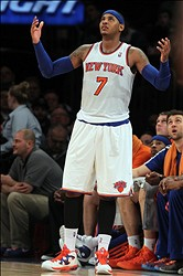 Nov 20, 2013; New York, NY, USA; New York Knicks small forward Carmelo Anthony (7) reacts during the third quarter at Madison Square Garden. The Pacers defeated the Knicks 103-96 in overtime. Mandatory Credit: Brad Penner-USA TODAY Sports
