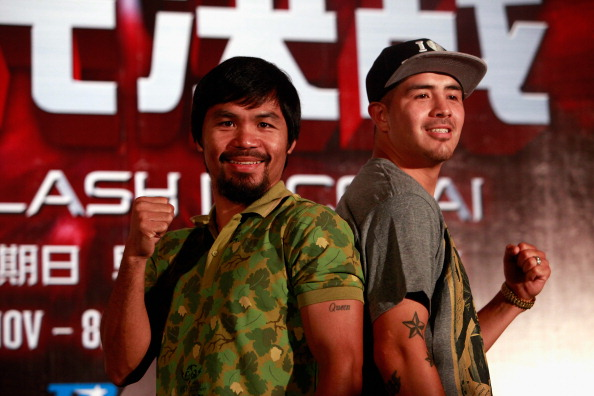 SHANGHAI, CHINA - JULY 31:  Manny Pacquiao (L) and Brandon Rios (R) pose for a picture during a press conference on July 31, 2013 in Shanghai, China.  (Photo by Kevin Lee/Getty Images)