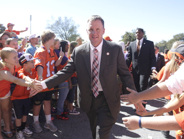 CLEMSON, SC - OCTOBER 12: Chad Morris Offensive Coordinator of the Clemson Tigers greets fans during the Tigerwalk prior to the game against the Boston College Eagles at Memorial Stadium on October 12, 2013 in Clemson, South Carolina. (Photo by Tyler Smith/Getty Images)