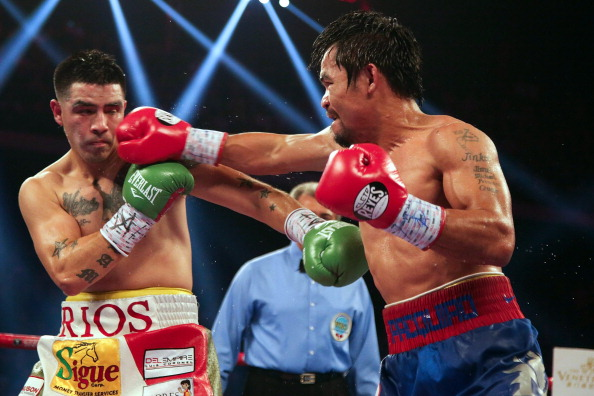 MACAU - NOVEMBER 24:  Manny Pacquiao (R) of the Philippines punches Brandon Rios of the U.S. during their 'Clash in Cotai' WBO International Welterweight title fight on November 24, 2013 in Macau.  (Photo by Nicky Loh/Getty Images)