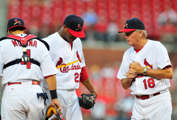 ST. LOUIS, MO - AUGUST 14: Dave Duncan #18 of the St. Louis Cardinals talks with Edwin Jackson #22 and Yadier Molina #4 during a game against the Colorado Rockies at Busch Stadium on August 14, 2011 in St. Louis, Missouri.  (Photo by Jeff Curry/Getty Images)