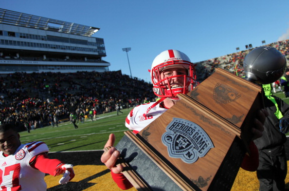 IOWA CITY, IA - NOVEMBER 23:  Long snapper P.J. Mangieri #92 of the Nebraska Cornhuskers carries the Heroes Game trophy after the game against the Iowa Hawkeyes on November 23, 2012 at Kinnick Stadium in Iowa City, Iowa. Nebraska defeated Iowa 13-7.  (Photo by Matthew Holst/Getty Images)