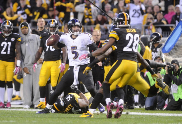 PITTSBURGH, PA - OCTOBER 20: Joe Flacco #5 of the Baltimore Ravens tries to escape the rush of Lamar Woodley #56 of the Pittsburgh Steelers during the third quarter at Heinz Field on October 20, 2013 in Pittsburgh, Pennsylvania. (Photo by Vincent Pugliese/Getty Images)