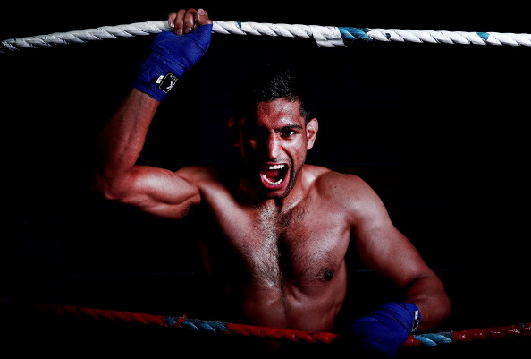 BOLTON, ENGLAND - APRIL 22:  Amir Khan poses during a photo shoot at Gloves Gym on April 22, 2013 in Bolton, England.  (Photo by Scott Heavey/Getty Images)