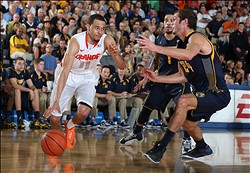Nov 26, 2013; Lahaina, HI, USA; Syracuse Orangemen guard Tyler Ennis (11) drives to the basket against California Golden Bears forward Ricky Kreklow (24) during the second round of the EA Sports Maui Invitational at Lahaina Civic Center. Syracuse defeats California 92-81. Mandatory Credit: Brian Spurlock-USA TODAY Sports