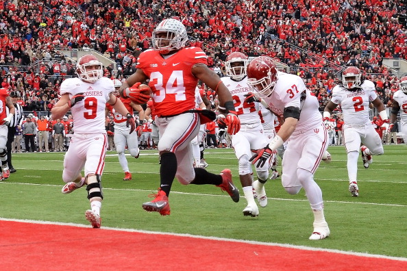 COLUMBUS, OH - NOVEMBER 23:  Carlos Hyde #34 of the Ohio State Buckeyes completes a 16-yard run for a touchdown in the first quarter against the Indiana Hoosiers at Ohio Stadium on November 23, 2013 in Columbus, Ohio.  (Photo by Jamie Sabau/Getty Images)