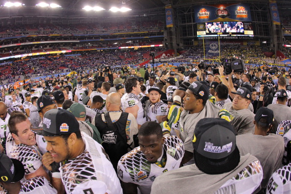 GLENDALE, AZ - JANUARY 03:  The Oregon Ducks celebrate their 35 to 17 win over the Kansas State Wildcats in the Tostitos Fiesta Bowl at University of Phoenix Stadium on January 3, 2013 in Glendale, Arizona.  (Photo by Doug Pensinger/Getty Images)