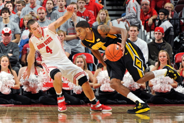 COLUMBUS, OH - JANUARY 22:  Aaron Craft #4 of the Ohio State Buckeyes defends as Roy Devyn Marble #4 of the Iowa Hawkeyes drives the baseline in the second half on January 22, 2013 at Value City Arena in Columbus, Ohio. Ohio State defeated Iowa 72-63.  (Photo by Jamie Sabau/Getty Images)