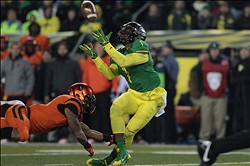 Nov 29, 2013; Eugene, OR, USA; Oregon Ducks wide receiver Josh Huff (1) catches the ball as Oregon State Beavers cornerback Sean Martin (6) defends at Matthew Knight Arena. Mandatory Credit: Scott Olmos-USA TODAY Sports