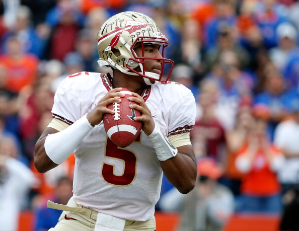 GAINESVILLE, FL - NOVEMBER 30:  Jameis Winston #5 of the Florida State Seminoles attempts a pass during the game against the Florida Gators on November 30, 2013 in Gainesville, Florida.  (Photo by Sam Greenwood/Getty Images)