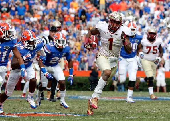 GAINESVILLE, FL - NOVEMBER 30:  Kelvin Benjamin #1 of the Florida State Seminoles runs for yardage during the game against the Florida Gators on November 30, 2013 in Gainesville, Florida.  (Photo by Sam Greenwood/Getty Images)