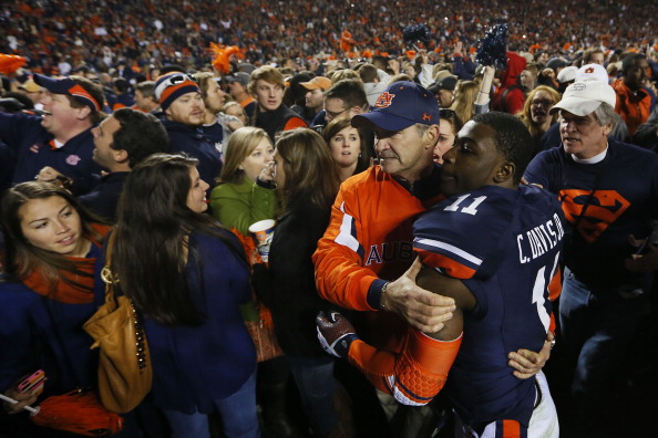 AUBURN, AL - NOVEMBER 30:  Chris Davis #11 of the Auburn Tigers is surrounded after scoring the winning touchdown to defeat the Alabama Crimson Tide 34 to 28 at Jordan-Hare Stadium on November 30, 2013 in Auburn, Alabama.  (Photo by Kevin C. Cox/Getty Images)