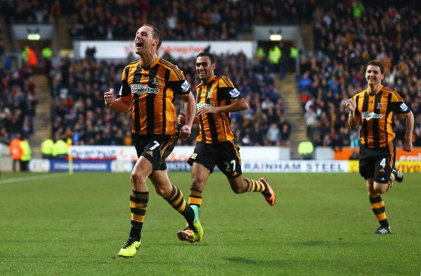 HULL, ENGLAND - DECEMBER 01:  David Meyler (L) of Hull City celebrates scoring his team's second goal with team mates during the Barclays Premier League match between Hull City and Liverpool at KC Stadium on December 1, 2013 in Hull, England.  (Photo by Matthew Lewis/Getty Images)
