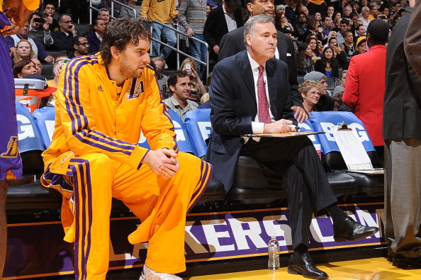LOS ANGELES, CA - NOVEMBER 30: Pau Gasol #16 and head coach Mike D'Antoni of the Los Angeles Lakers sit on the bench before a game against the Denver Nuggets at Staples Center on November 30, 2012 in Los Angeles, California. NOTE TO USER: User expressly acknowledges and agrees that, by downloading and/or using this Photograph, user is consenting to the terms and conditions of the Getty Images License Agreement. Mandatory Copyright Notice: Copyright 2012 NBAE (Photo by Andrew D. Bernstein/NBAE via Getty Images)