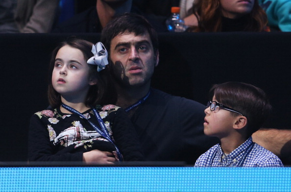 LONDON, ENGLAND - NOVEMBER 08: Snooker player Ronnie O'Sullivan and children watch the men's singles match between Tomas Berdych of the Czech Republic and Rafael Nadal of Spain during day five of the Barclays ATP World Tour Finals at O2 Arena on November 8, 2013 in London, England.  (Photo by Clive Brunskill/Getty Images)