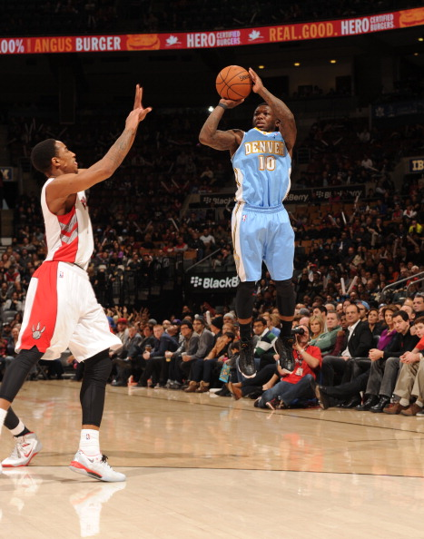 TORONTO, CANADA - December 1: Nate Robinson #10 of the Denver Nuggets shoots the ball against the Toronto Raptors during the game on December 1, 2013 at the Air Canada Centre in Toronto, Ontario, Canada.  NOTE TO USER: User expressly acknowledges and agrees that, by downloading and or using this Photograph, user is consenting to the terms and conditions of the Getty Images License Agreement.  Mandatory Copyright Notice: Copyright 2013 NBAE (Photo by Ron Turenne/NBAE via Getty Images)