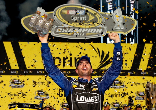 HOMESTEAD, FL - NOVEMBER 17:  Jimmie Johnson, driver of the #48 Lowe's/Kobalt Tools Chevrolet, celebrates in Champions Victory Lane after winning the series championship following the NASCAR Sprint Cup Series Ford EcoBoost 400 at Homestead-Miami Speedway on November 17, 2013 in Homestead, Florida.  (Photo by Chris Graythen/Getty Images)