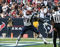 Dec 1, 2013; Houston, TX, USA; New England Patriots tight end Rob Gronkowski (87) spikes the football after a touchdown reception in the first quarter against the Houston Texans at Reliant Stadium. Mandatory Credit: Matthew Emmons-USA TODAY Sports