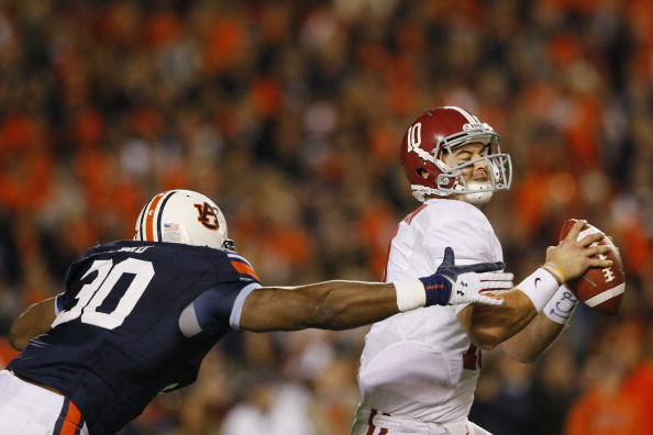 AUBURN, AL - NOVEMBER 30:  AJ McCarron #10 of the Alabama Crimson Tide is pressured by Dee Ford #30 of the Auburn Tigers in the third quarter at Jordan-Hare Stadium on November 30, 2013 in Auburn, Alabama.  (Photo by Kevin C. Cox/Getty Images)