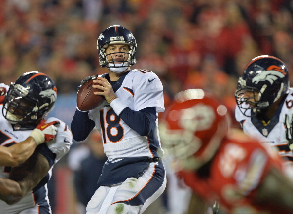 KANSAS CITY, MO - DECEMBER 01:  Quarterback Peyton Manning #18 of the Denver Broncos drops back to pass against the Kansas City Chiefs during the second half on December 1, 2013 at Arrowhead Stadium in Kansas City, Missouri.  Denver beat Kansas City 35-28.  (Photo by Peter Aiken/Getty Images)
