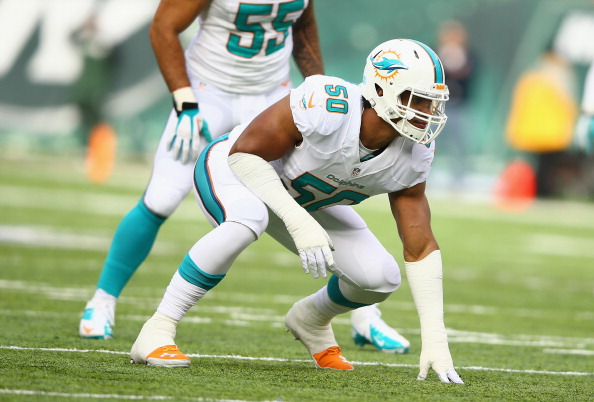 EAST RUTHERFORD, NJ - DECEMBER 01:   Olivier Vernon #50 of the Miami Dolphins in action against the Miami Dolphins during their game at MetLife Stadium on December 1, 2013 in East Rutherford, New Jersey.  (Photo by Al Bello/Getty Images)