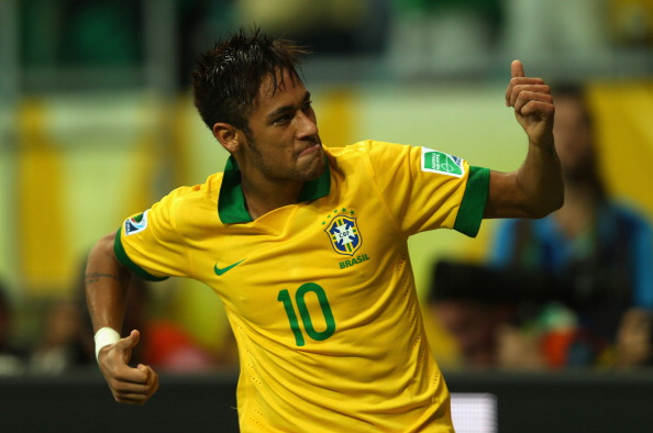 SALVADOR, BRAZIL - JUNE 22:  Neymar of Brazil celebrates as he scores their second goal from a free kick during the FIFA Confederations Cup Brazil 2013 Group A match between Italy and Brazil at Estadio Octavio Mangabeira (Arena Fonte Nova Salvador) on June 22, 2013 in Salvador, Brazil.  (Photo by Clive Rose/Getty Images)