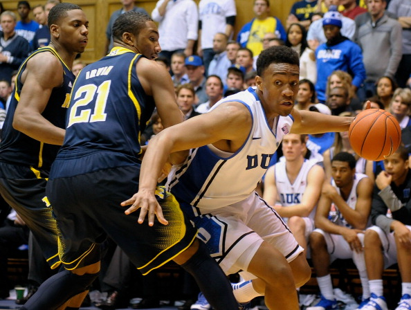 DURHAM, NC - DECEMBER 03:  Jabari Parker #1 of the Duke Blue Devils drives the baseline against Zak Irvin #21 of the Michigan Wolverines during play at Cameron Indoor Stadium on December 3, 2013 in Durham, North Carolina. Duke won 79-69.  (Photo by Grant Halverson/Getty Images)