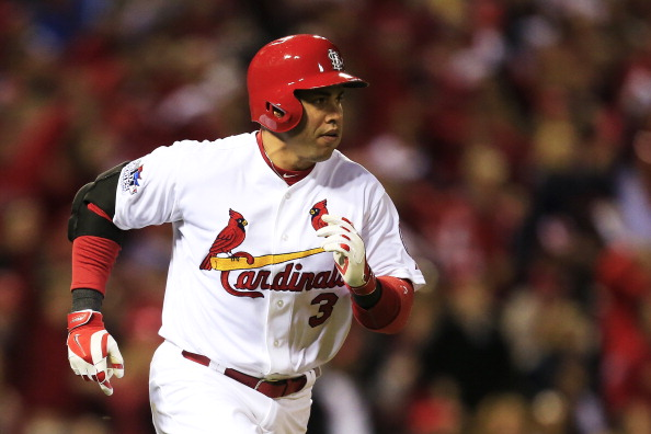 ST LOUIS, MO - OCTOBER 27:  Carlos Beltran #3 of the St. Louis Cardinals runs to first after hitting a single to center field in the third inning against Clay Buchholz #11 of the Boston Red Sox scoring teammate Matt Carpenter #13 during Game Four of the 2013 World Series at Busch Stadium on October 27, 2013 in St Louis, Missouri.  (Photo by Dilip Vishwanat/Getty Images)