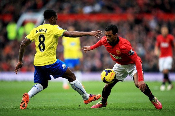 MANCHESTER, ENGLAND - DECEMBER 07:  Nani of Manchester United is challenged by Vurnon Anita of Newcastle during the Barclays Premier League match between Manchester United and Newcastle United at Old Trafford on December 7, 2013 in Manchester, England.  (Photo by Richard Heathcote/Getty Images)