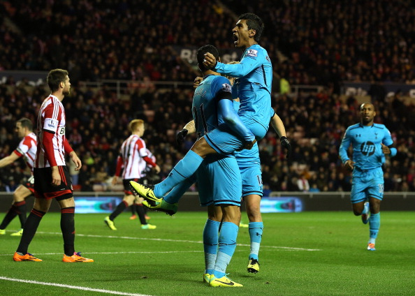 SUNDERLAND, ENGLAND - DECEMBER 07:  Paulinho of Tottenham celebrates his goal with team mate Nacer Chadli during the Barclays Premier League match between Sunderland and Tottenham Hotspur at the Stadium of Light on December 7, 2013 in Sunderland, England.  (Photo by Jan Kruger/Getty Images)