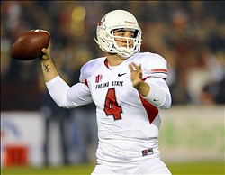 Oct 26, 2013; San Diego, CA, USA; Fresno State Bulldogs quarterback Derek Carr (4) passes the ball during the first half against the San Diego State Aztecs at Qualcomm Stadium. Mandatory Credit: Christopher Hanewinckel-USA TODAY Sports