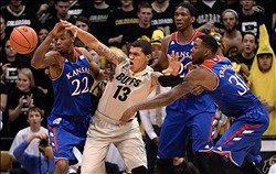 Dec 7, 2013; Boulder, CO, USA; Kansas Jayhawks guard Andrew Wiggins (22) and center Joel Embiid (21) and forward Jamari Traylor (31) defend on Colorado Buffaloes forward Dustin Thomas (13) in the first half at Coors Events Center. Mandatory Credit: Ron Chenoy-USA TODAY Sports