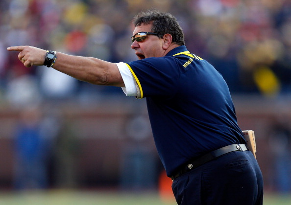 ANN ARBOR, MI - NOVEMBER 30:  Head coach Brady Hoke of the Michigan Wolverines looks on against the Ohio State Buckeyes during a game at Michigan Stadium on November 30, 2013 in Ann Arbor, Michigan.  (Photo by Gregory Shamus/Getty Images)