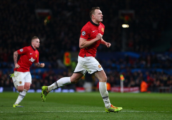 MANCHESTER, ENGLAND - DECEMBER 10:  Phil Jones of Manchester United celebrates scoring the opening goal during the UEFA Champions League Group A match between Manchester United and Shakhtar Donetsk at Old Trafford on December 10, 2013 in Manchester, England.  (Photo by Michael Steele/Getty Images)